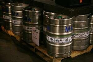 Kegs of beer line the floor at the Speakeasy Brewery.