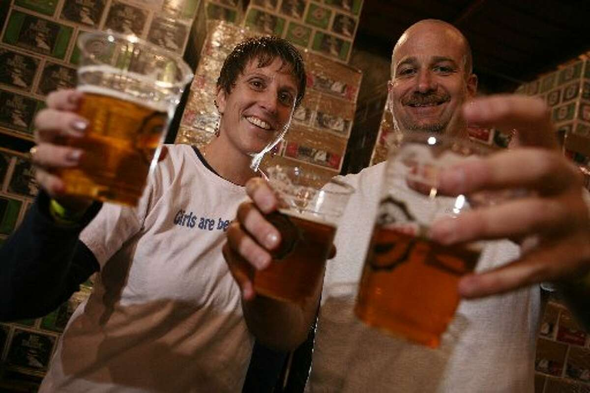 Merideth Canham-Nelson and Chris Nelson with beer from the Speakeasy Brewery.