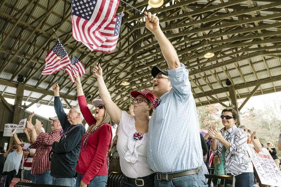 Supporters of President Trump wave American flags while listening to a speaker during a rally led by GatorPAC, a political action committee, in Mandeville, La., on Feb. 27. Photo: WILLIAM WIDMER, NYT