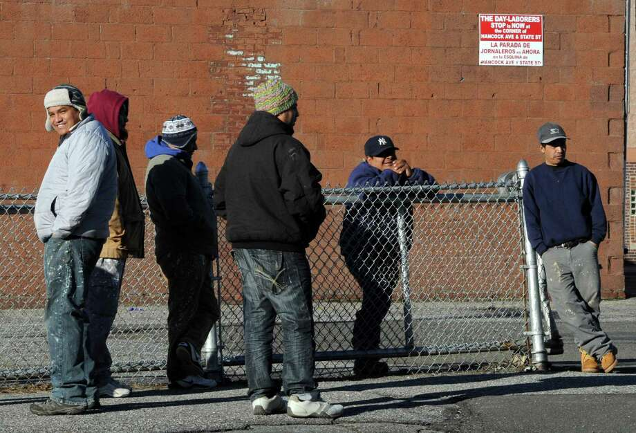 Day laborers hoping for work wait at the designated site at the corner of State Street and Hancock Avenue in Bridgeport, Conn. on Thursday, March 9, 2017 Photo: Cathy Zuraw / Hearst Connecticut Media / Connecticut Post