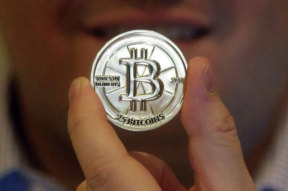 U.S. regulators rejected an exchange-traded fund based on bitcoin, wiping out weeks of gains for the digital currency as investors speculated the Securities and Exchange Commission would approve the security. Photo: Associated Press /File Photo / AP