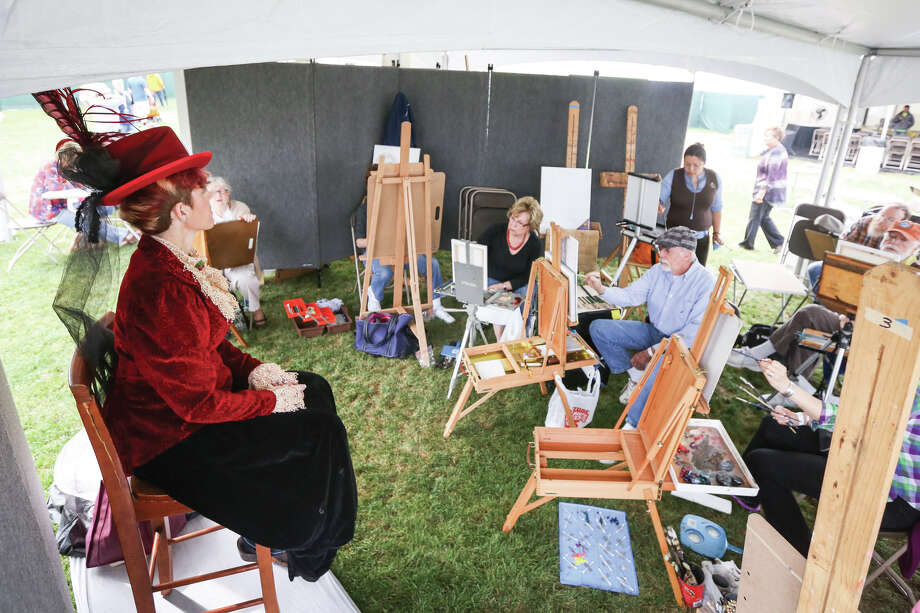 Professional artists do a public demonstration by live drawing a model during The Woodlands Waterway Arts Festival on Saturday, April 11, 2015, on The Woodlands Waterway near Town Green Park. Photo: Michael Minasi, Staff Photographer / © 2017 Houston Chronicle