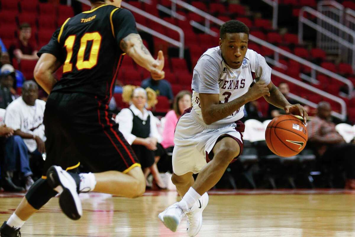Texas Southern Tigers guard Demontrae Jefferson (3) dribbles past Grambling State Tigers guard Chase Cormier (10) as the Texas Southern Tigers take on the Grambling State Tigers during the SWAC Basketball Tournament semifinals at the Toyota Center Friday, March 10, 2017 in Houston.
