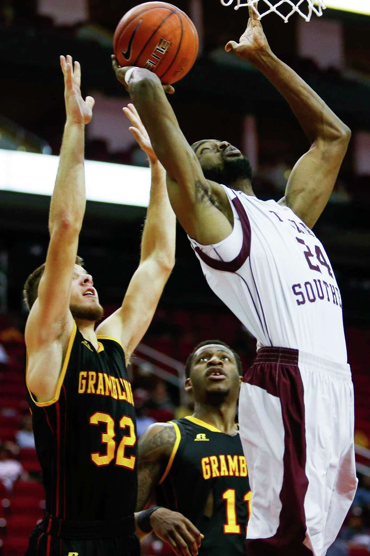 Texas Southern Tigers center Marvin Jones (24) puts up a shot past Grambling State Tigers guard Drake Wilks (32) as the Texas Southern Tigers take on the Grambling State Tigers during the SWAC Basketball Tournament semifinals at the Toyota Center Friday, March 10, 2017 in Houston.