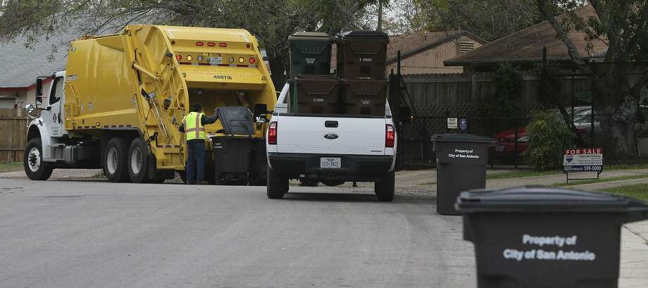 Garbage is collected Nov. 30, 2015, in the Camelot II neighborhood after Bexar County and the city of San Antonio forged an agreement to start service in a particularly trashed portion of the Northeast Side neighborhood. Another development portends even better service for Camelot and the Glen. The city of Converse is proposing to annex them. Photo: San Antonio Express-News File Photo / ©San Antonio Express-News/John Davenport