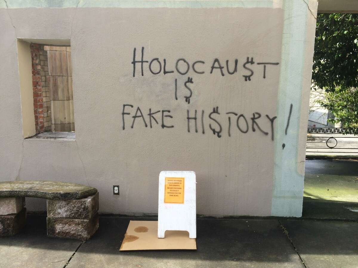 Hate graffiti at Temple de Hirsch Sinai. The small sign at the bottom says that the temple is leaving the graffiti up to allow it to be exposed. Senior rabbi Daniel Weiner was among faithrath leaders who met Thursday with Gov. Jay Inslee.