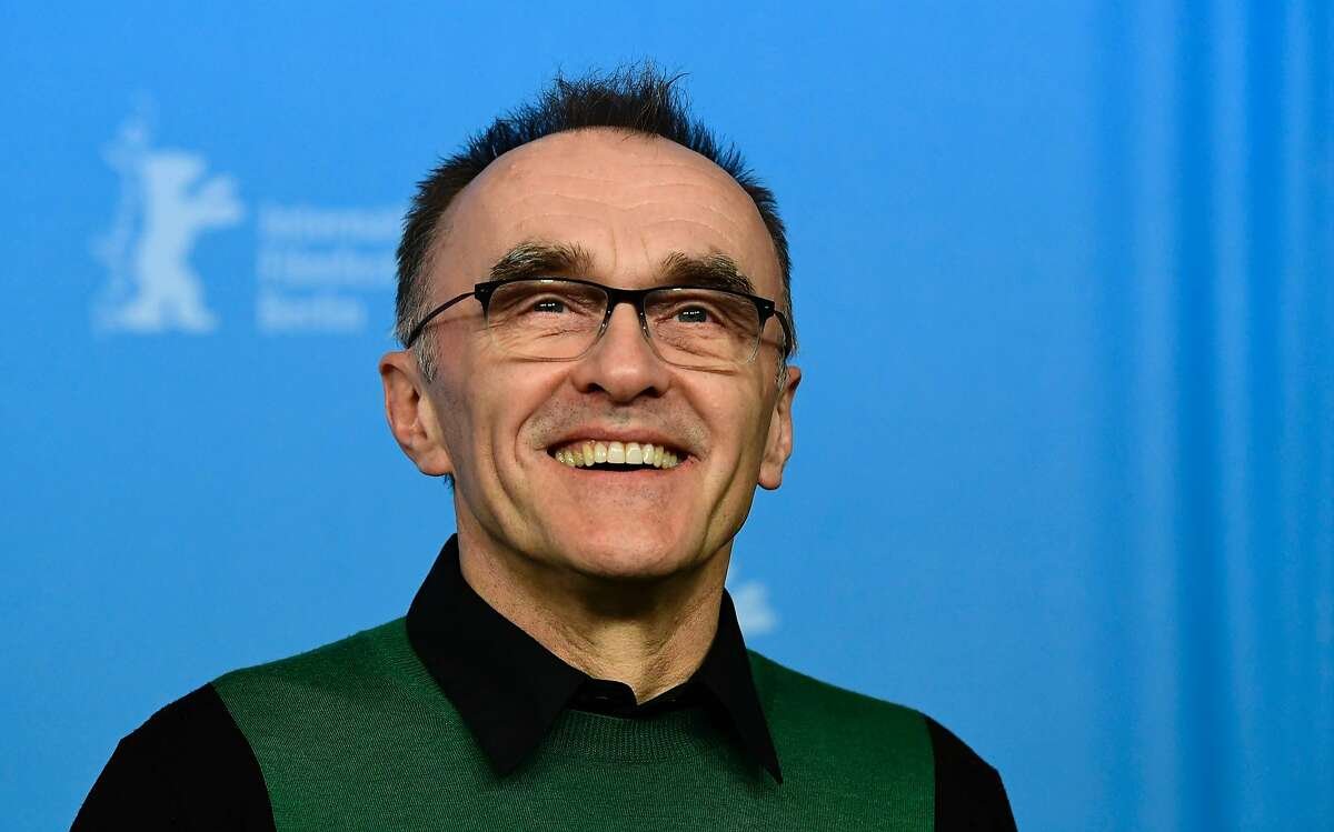 (FILES) This file photo taken on February 10, 2017 shows British director Danny Boyle posing for photographers during a photocall for the film
