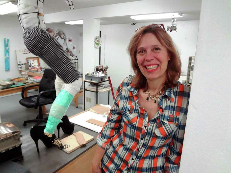 Artist Jayne Lawrence works in an old metal building that she has converted into a studio that offers her plenty of space to make art, including the sculpture-in-progress behind her. Photo: Steve Bennett / San Antonio Express-News