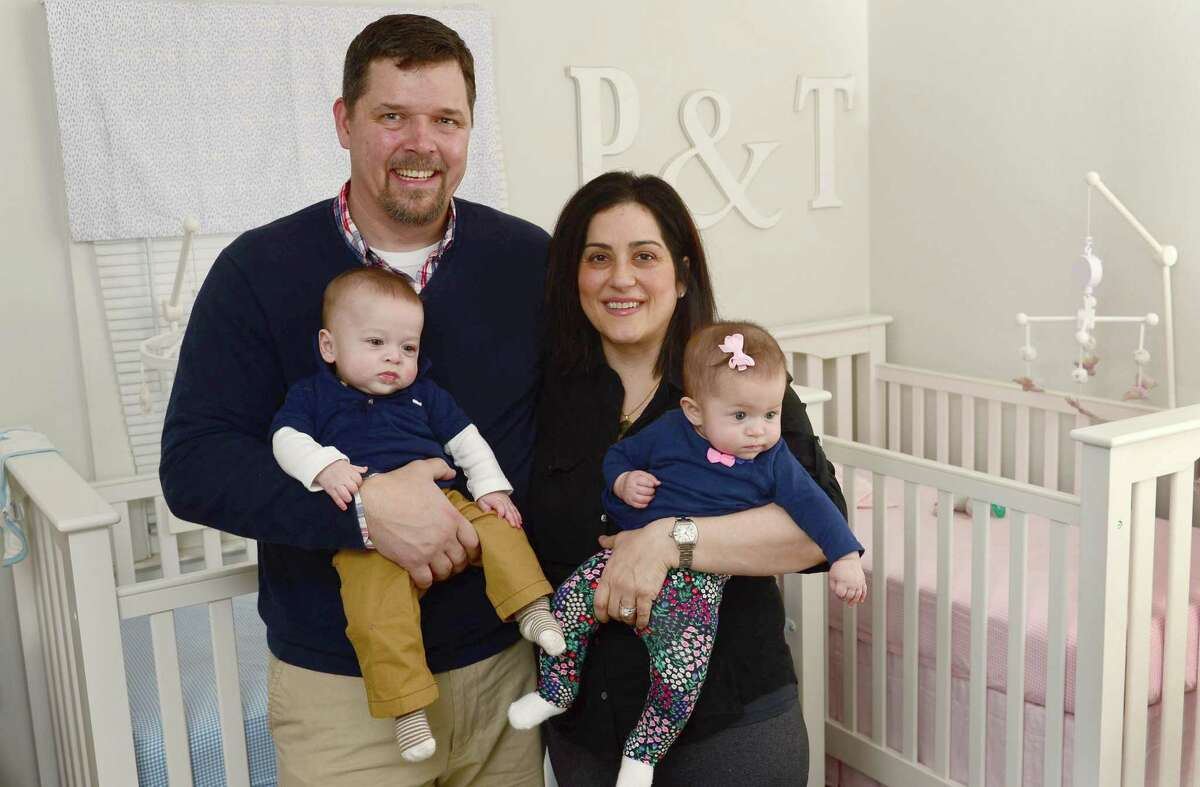Todd and Jessica Frascarelli with their twins, Parker and TJ, 7 months, at their home Wednesday, February 22, 2017, in Stamford, Conn. The Facarelli's took advantage of a new invitro fertilization test, a Endometrium Receptivity Array (ERA), which helped them conceive their children. ERA is a diagnostic procedure that evaluates cells from a patient to determine when a woman?'s body is most receptive to implantation. Jessica had four IVF cycles without a successful full-term pregnancy until their doctor introduced them to ERA.