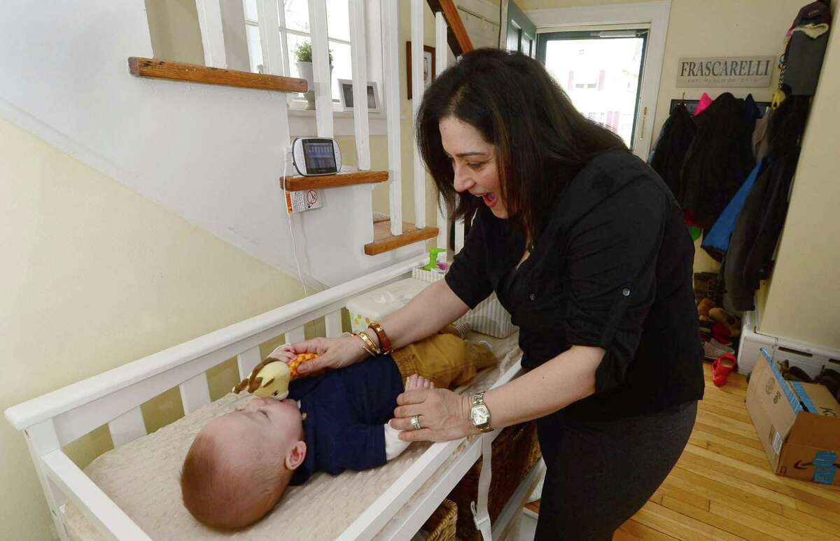Jessica Frascarelli with one of her twins, TJ, 7 months, at their home Wednesday, February 22, 2017, in Stamford, Conn. Jessica and her husband Todd Facarelli took advantage of a new invitro fertilization test, a Endometrium Receptivity Array (ERA), which helped them conceive their children. ERA is a diagnostic procedure that evaluates cells from a patient to determine when a woman?'s body is most receptive to implantation. Jessica had four IVF cycles without a successful full-term pregnancy until their doctor introduced them to ERA.
