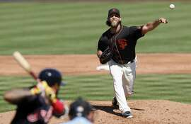 SCOTTSDALE, AZ - MARCH 10:  Madison Bumgarner #40 of the San Francisco Giants pitches in the second inning against the Cleveland Indians during the spring training game at Scottsdale Stadium on March 10, 2017 in Scottsdale, Arizona.  (Photo by Tim Warner/Getty Images)