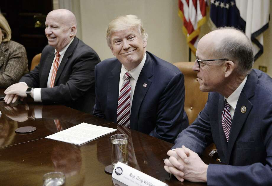 U.S. President Donald Trump, center, smiles as Representative Greg Walden, a Republican from Oregon, right, and Representative Kevin Brady, a Republican from Texas, sit during a discussion on health care in the Roosevelt Room of the White House in Washington, D.C. U.S., on Friday, March 10, 2017. Despite opposition from some conservatives, Trump on Friday predicted fairly rapid approval of a replacement to President Obama's health care law. Photographer: Olivier Douliery/Pool via Bloomberg Photo: Olivier Douliery, Bloomberg