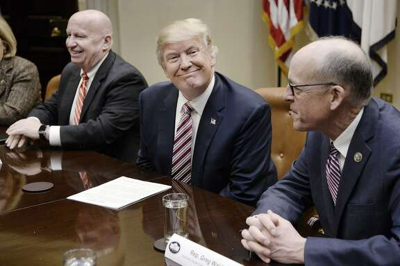 U.S. President Donald Trump, center, smiles as Representative Greg Walden, a Republican from Oregon, right, and Representative Kevin Brady, a Republican from Texas, sit during a discussion on health care in the Roosevelt Room of the White House in Washington, D.C. U.S., on Friday, March 10, 2017. Despite opposition from some conservatives, Trump on Friday predicted fairly rapid approval of a replacement to President Obama's health care law. Photographer: Olivier Douliery/Pool via Bloomberg