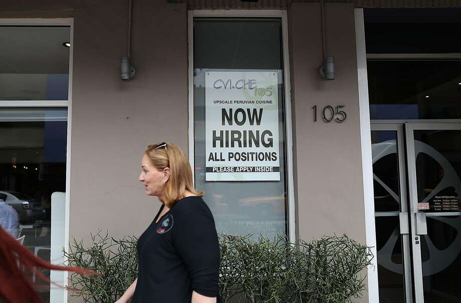 A Now Hiring sign is seen. Photo: Joe Raedle, Getty Images
