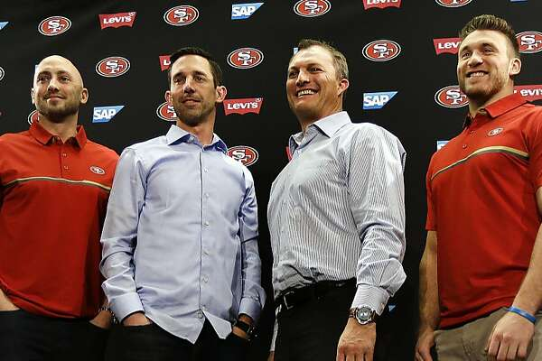 From left to right, San Francisco 49ers' Pierre Gar�on, Marquise Goodwin, Robbie Gould, quarterback Brian Hoyer, head coach Kyle Shanahan, general manager John Lynch, Kyle Juszczyk, Logan Paulsen and Malcolm Smith stand for a photo at the end of a media conference Friday, March 10, 2017, in Santa Clara, Calif. (AP Photo/Ben Margot)