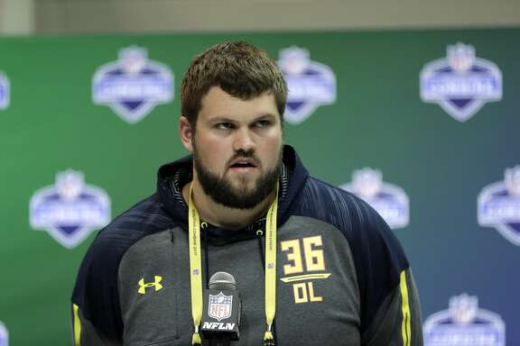 Wisconsin offensive lineman Ryan Ramczyk speaks during a news conference at the NFL football scouting combine Thursday, March 2, 2017, in Indianapolis. (AP Photo/David J. Phillip)