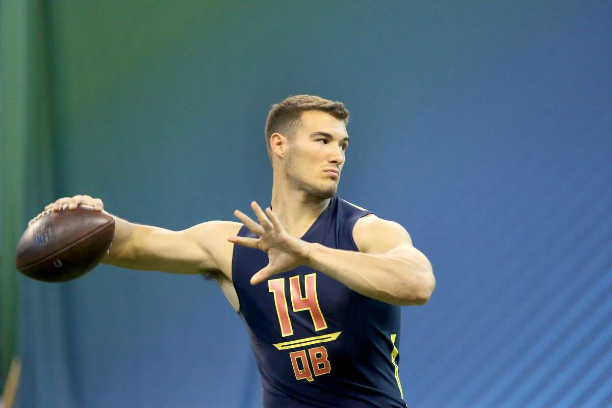 North Carolina quarterback Mitchell Trubisky is seen in a drill at the 2017 NFL football scouting combine Saturday, March 4, 2017, in Indianapolis. (AP Photo/Gregory Payan)