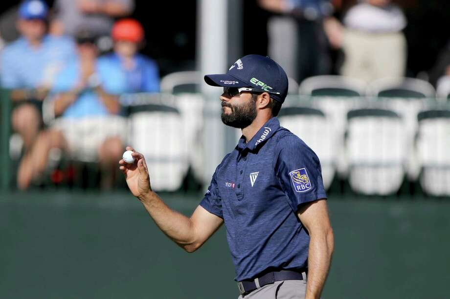 Adam Hadwin acknowledges the crowd moments after making a birdie at 17 while playing in the second round of the Valspar Golf Championship at Innisbrook Resort and Golf Club's Copperhead Course on Friday, March 10, 2017, in Palm Harbor, Fla. (Douglas R. Clifford/The Tampa Bay Times via AP) Photo: Douglas R. Clifford, MBI / Tampa Bay Times