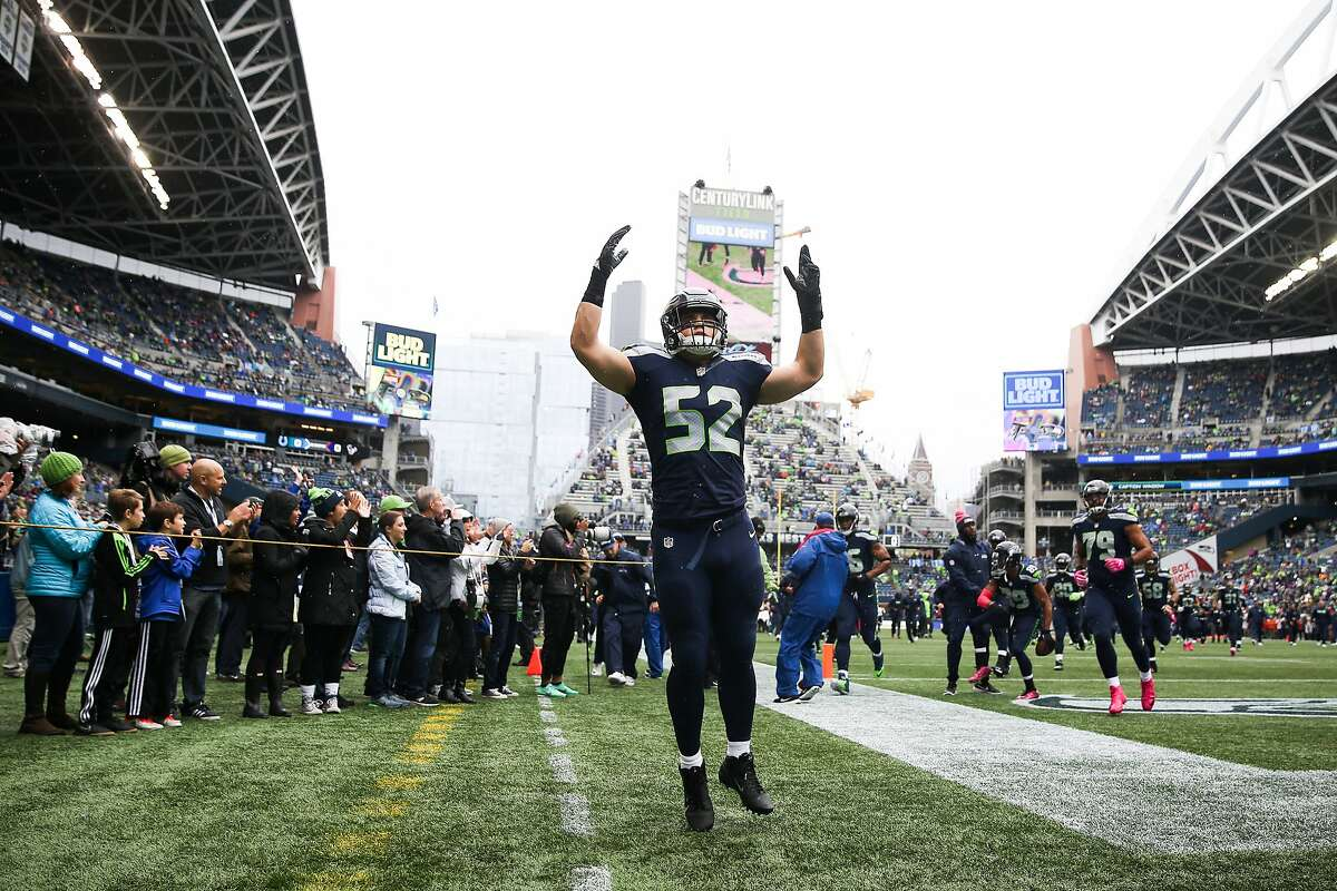 Seahawks linebacker Brock Coyle amps up the crowd before playing the Atlanta Falcons at CenturyLink Field, Sunday, Oct. 16, 2016.(GRANT HINDSLEY, seattlepi.com)