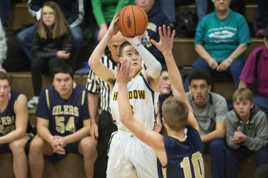 BRITTNEY LOHMILLER | blohmiller@mdn.net Dow's Ben Zeitler prepares to shoot for three points while being defended by Mount Pleasant's Noah Ingram in the first half of the Class A district finals at Bay City Central Friday evening. Mount Pleasant defeated Dow 44-35. Photo: Brittney Lohmiller/Midland Daily News/Brittney Lohmiller