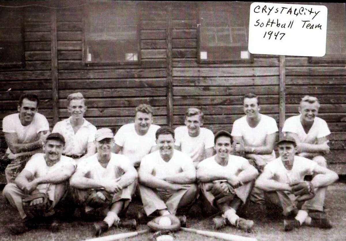 Photo of Eberhardt 'Eb' Fuhr on the fast pitch softball team while interned at Crystal City Internment Camp during WWII. Bottom L-R - Ted Roehner, Dietmar Seyferth, Hans 'John' Wiechers, Eb Fuhr, Gerhard Fuhr Top Row L-R - Julius Fuhr, N/A, Dr. Friedel, Al Krakau, Paul Ahrens, Bruno Koop.