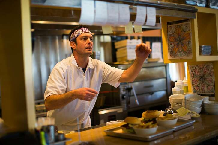 Co-owner and chef of Earthbelly, Chad Greer, works in the kitchen in Santa Cruz, Calif. Thursday, March 9, 2017.