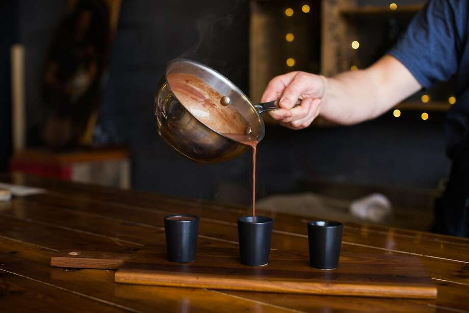 Stephen Beaumier serves up a tasting flight of chocolate at Mutari Chocolate in Santa Cruz. Photo: Mason Trinca, Special To The Chronicle