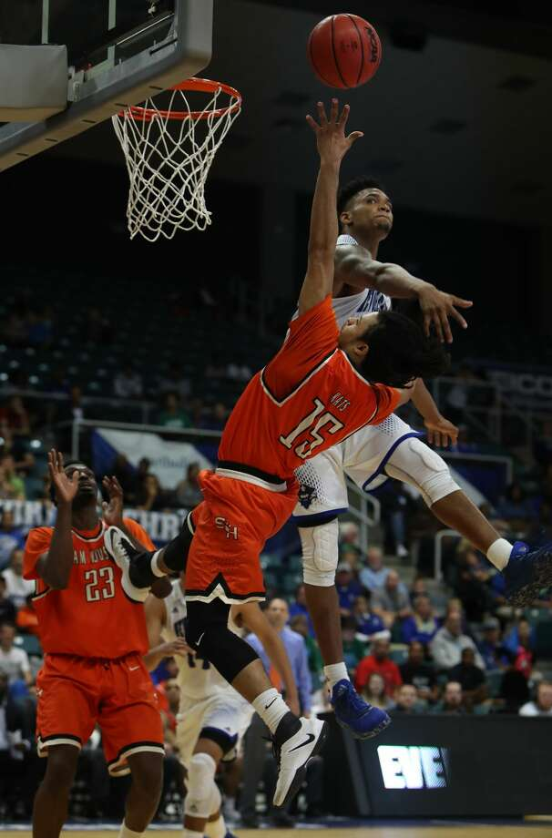 Sam Houston State guard Josh Delaney (15) gets off a shot under pressure by New Orleans forward Travin Thibodeaux (25) during second-half action in The Southland Conference Basketball Tournament in the Leonard E. Merrell Center  Friday, March 10, 2017, in Katy. ( Steve Gonzales  / Houston Chronicle ) Photo: Steve Gonzales/Houston Chronicle