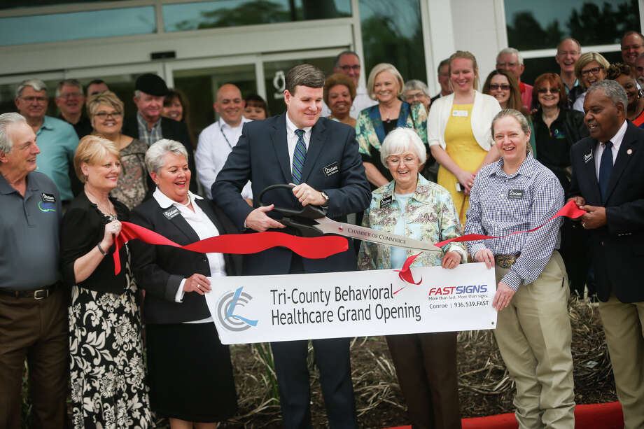 Tri-County Executive Director Evan Roberson cuts the ribbon while surrounded by several board members including chair Patti Atkins, Sharon Walker, Tracy Sorensen, Gail Page,Morris V. Johnson and Richard Duren during the grand opening ceremony on Friday, March 10, 2017, at Tri-County Behavioral Healthcare's new consolidated service facility on Sgt. Ed Holcomb Boulevard in Conroe. Photo: Michael Minasi, Staff Photographer / © 2017 Houston Chronicle