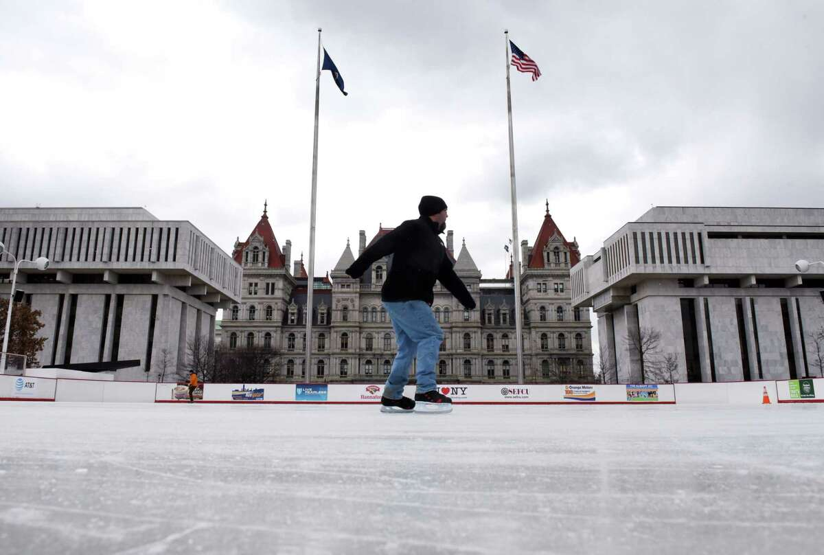 Ice skaters at the Empire State Plaza enjoy some lunchtime laps on Friday, March 10, 2017, in Albany, N.Y. The ice rink will close for the season after this weekend. (Will Waldron/Times Union)