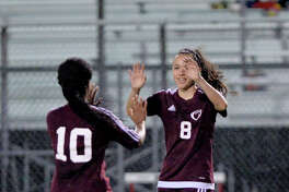Jennifer Garay (8) and Kennedy Verge (10) of Kempner celebrate their goal on a free kick during the first half of a girls high school soccer game between the Travis Tigers and the Kempner Cougars on Friday, March 10, 2017 at Travis High School, Richmond, TX.