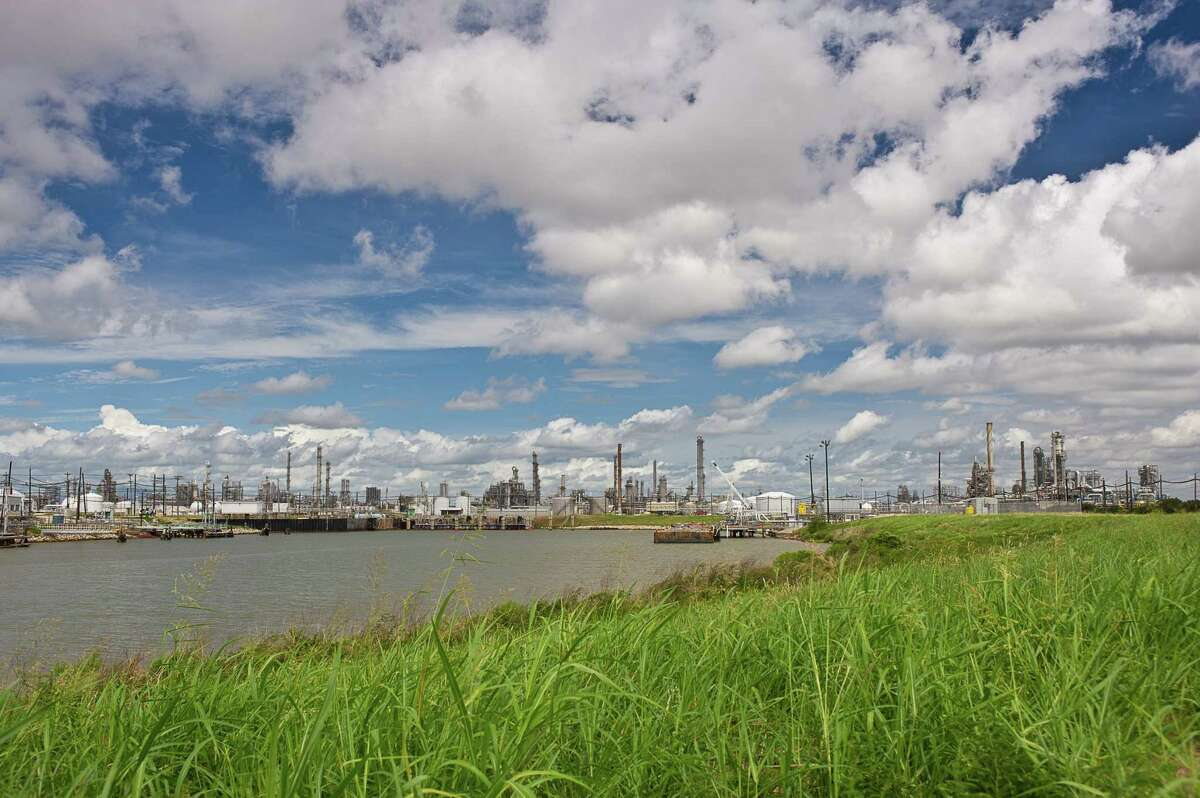 Several production plants rise above the coastal plain at Dow Chemical Co's. petrochemical complex near Freeport, Texas.
