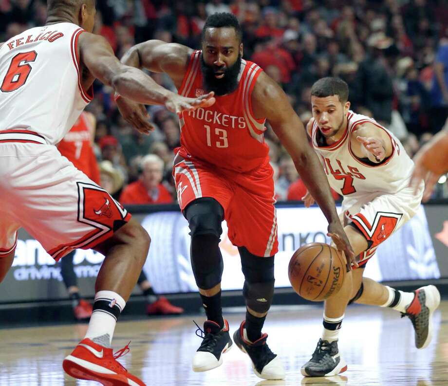 Houston Rockets guard James Harden (13) drives between Chicago Bulls forward Cristiano Felicio, left, and guard Michael Carter-Williams during the first half of an NBA basketball game Friday, March 10, 2017, in Chicago. (AP Photo/Nam Y. Huh) Photo: Nam Y. Huh, STF / Copyright 2017 The Associated Press. All rights reserved.