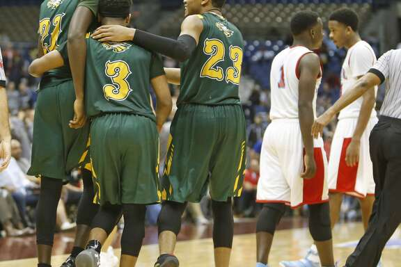 Cypress FallsÕs Kendall Scott (21),Cypress FallsÕs Trajan Wesley (3), and Cypress FallsÕs Nigel Hawkins (23) begin to celebrate after defeating Skyline from UIL Class 6A boys basketball semifinal between Skyline and Cypress Falls on Friday, March 10, 2017 at the Alamodome.  (Ronald Cortes/Special Contributor)