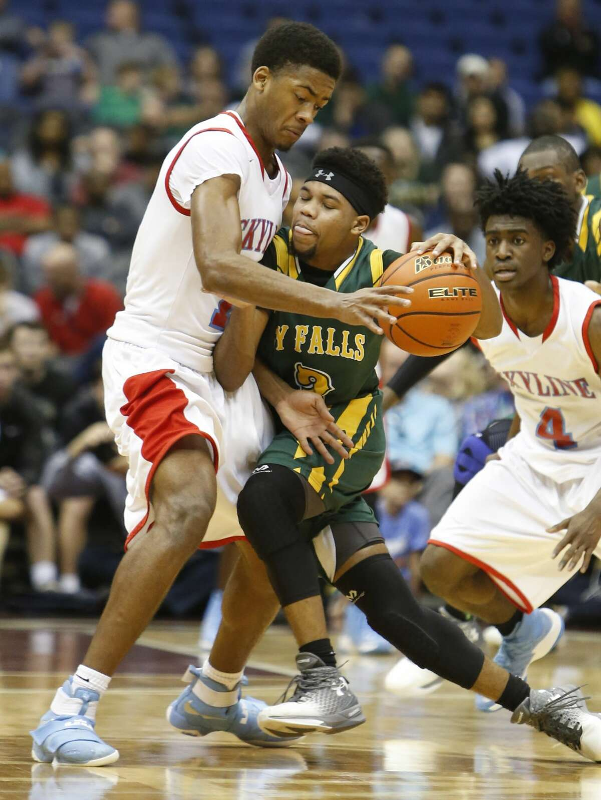 Dallas Skyline?•s Terreon Randolph (11) tries to trap Cypress Falls?•s Trajan Wesley (3) from UIL Class 6A boys basketball semifinal between Skyline and Cypress Falls on Friday, March 10, 2017 at the Alamodome. (Ronald Cortes/Special Contributor)