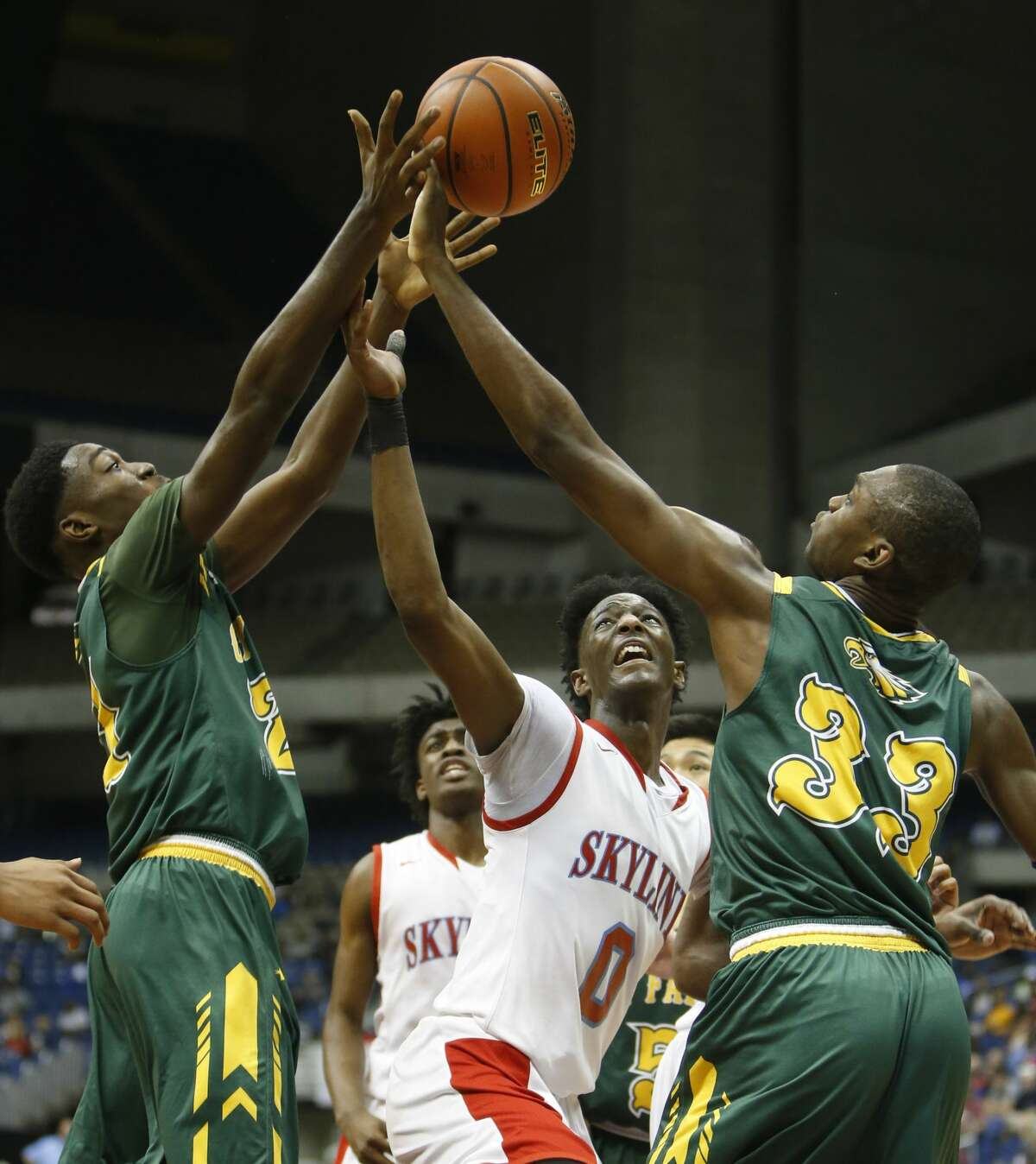 Dallas Skyline?•s Marcus Garrett (0) get score against Cypress Falls?•s Kendall Scott (21) and Cypress Falls?•s Deshang Weaver (33) from UIL Class 6A boys basketball semifinal between Skyline and Cypress Falls on Friday, March 10, 2017 at the Alamodome. (Ronald Cortes/Special Contributor)