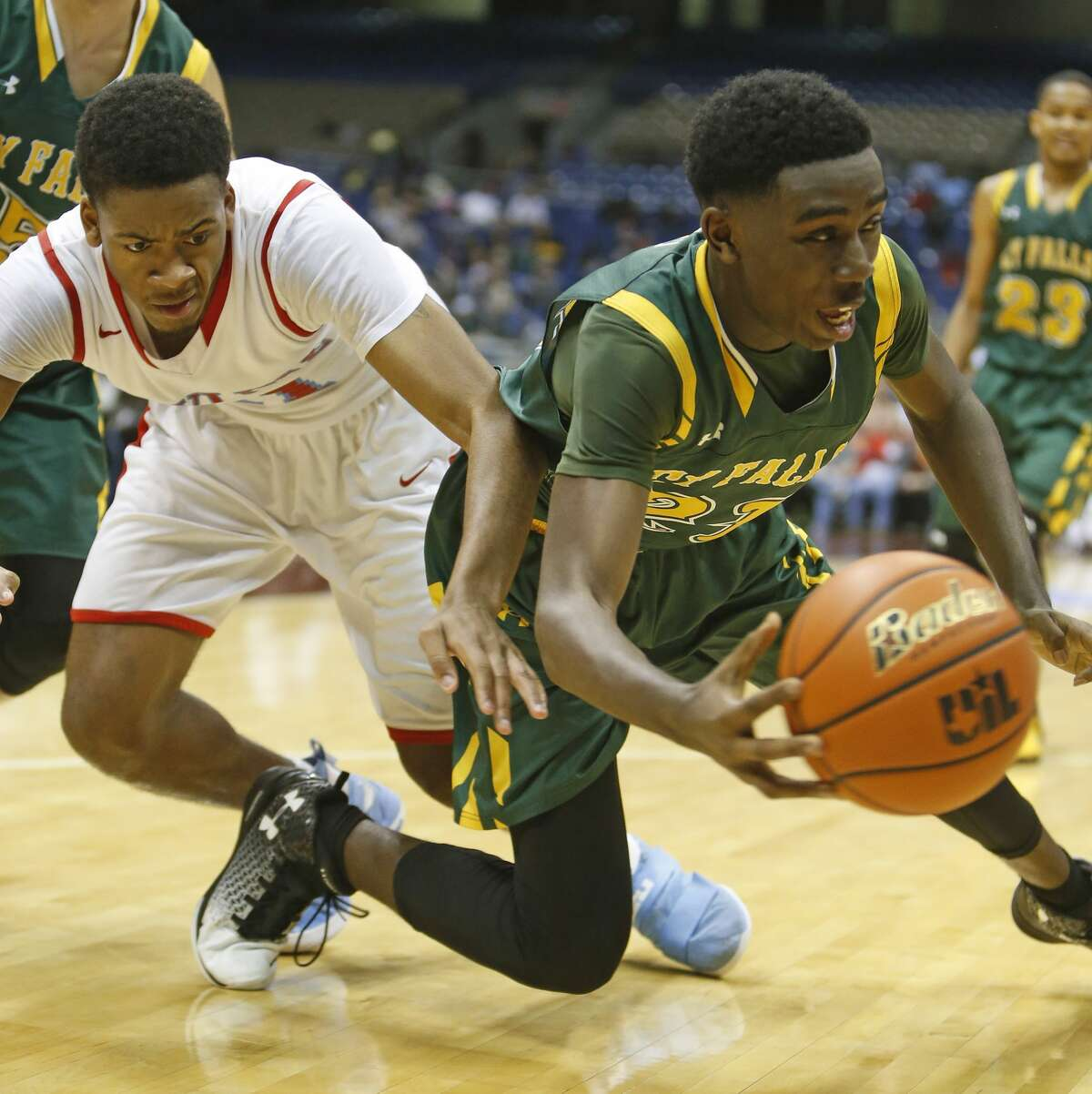 Cypress Falls?•s Kendall Scott (21) steals the ball away from Dallas Skyline?•s Terreon Randolph (11) from UIL Class 6A boys basketball semifinal between Skyline and Cypress Falls on Friday, March 10, 2017 at the Alamodome. (Ronald Cortes/Special Contributor)