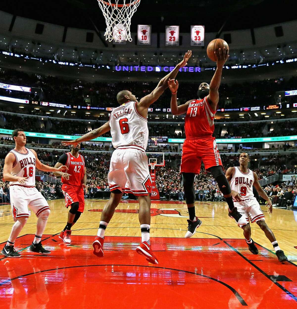 CHICAGO, IL - MARCH 10: James Harden #13 of the Houston Rockets puts up a shot over Cristiano Felicio #6 of the Chicago Bulls at the United Center on March 10, 2017 in Chicago, Illinois. The Rockets defeated the Bulls 115-94. NOTE TO USER: User expressly acknowledges and agrees that, by downloading and/or using this photograph, user is consenting to the terms and conditions of the Getty Images License Agreement. (Photo by Jonathan Daniel/Getty Images)
