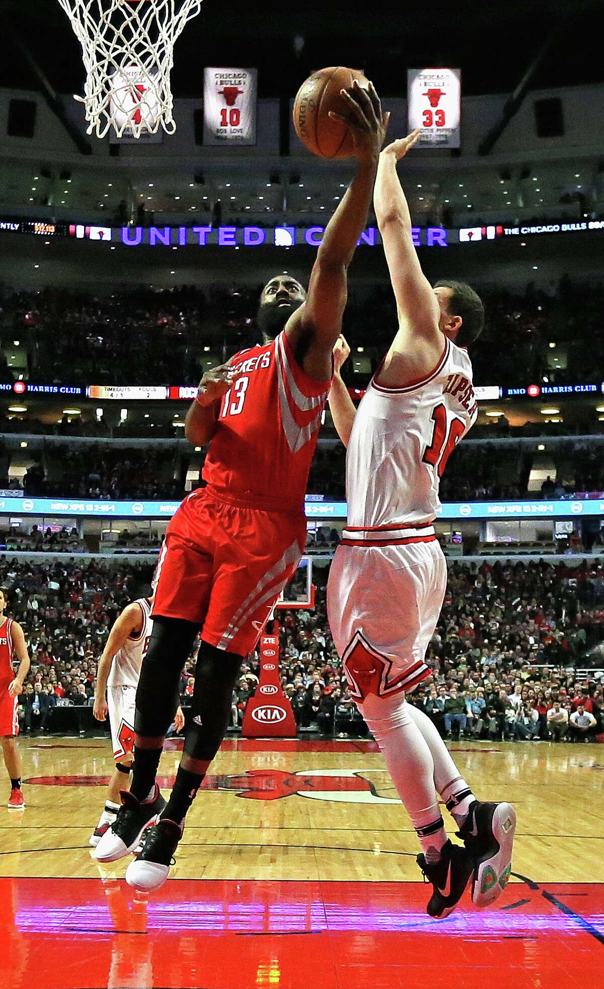 CHICAGO, IL - MARCH 10: James Harden #13 of the Houston Rockets puts up a shot Paul Zipser #16 of the Chicago Bulls at the United Center on March 10, 2017 in Chicago, Illinois. The Rockets defeated the Bulls 115-94. NOTE TO USER: User expressly acknowledges and agrees that, by downloading and/or using this photograph, user is consenting to the terms and conditions of the Getty Images License Agreement. (Photo by Jonathan Daniel/Getty Images)