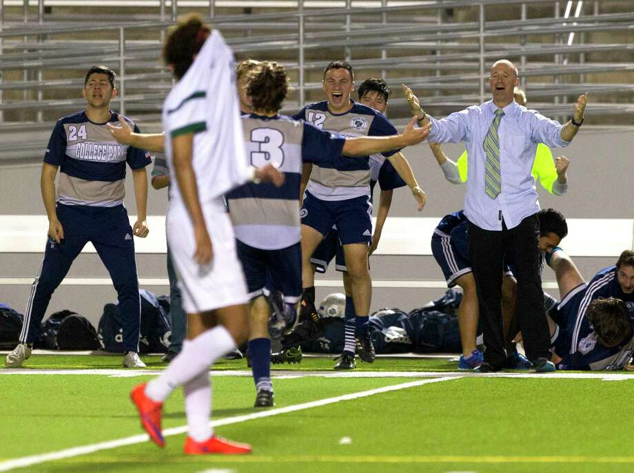 College Park defender Chris Soudah (12) and head coach John Owens react as midfielder Jaxon Whittington runs toward them after his go-ahead goal with 29 second left in the second period of a District 12-6A high school boys soccer match at Woodforest Bank Stadium Friday, March 10, 2017, in Shenandoah. College Park defeated The Woodlands 4-3. Photo: Jason Fochtman, Staff Photographer / © 2017 Houston Chronicle