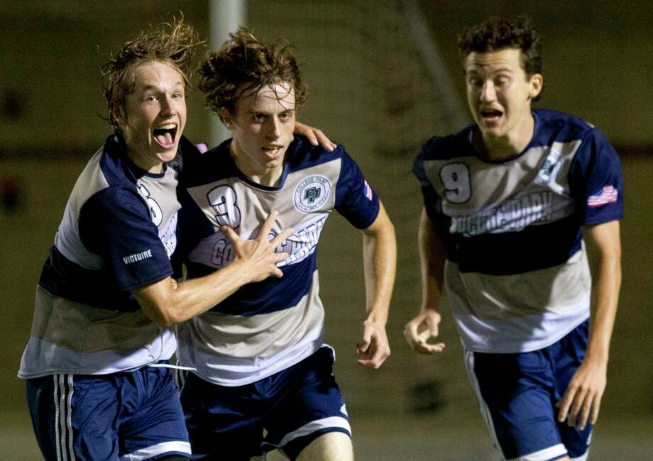 College Park defenseman Brady Burns (5) and forward Matt Freeman (9) celebrate after midfielder Jaxon Whittington's go-ahead goal with 29 second left in the second period of a District 12-6A high school boys soccer match at Woodforest Bank Stadium Friday, March 10, 2017, in Shenandoah. College Park defeated The Woodlands 4-3. Photo: Jason Fochtman, Staff Photographer / © 2017 Houston Chronicle