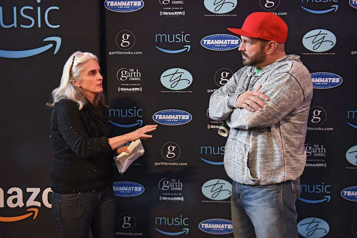 Times Union reporter Amy Biancolli engages in a one-on-one interview with Garth Brooks after a press conference at the Times Union Center on Friday, March. 10, 2017 in Albany, N.Y. Brooks and his wife Trisha Yearwood will be performing for three nights at the Times Union Center starting tonight. (Lori Van Buren / Times Union)