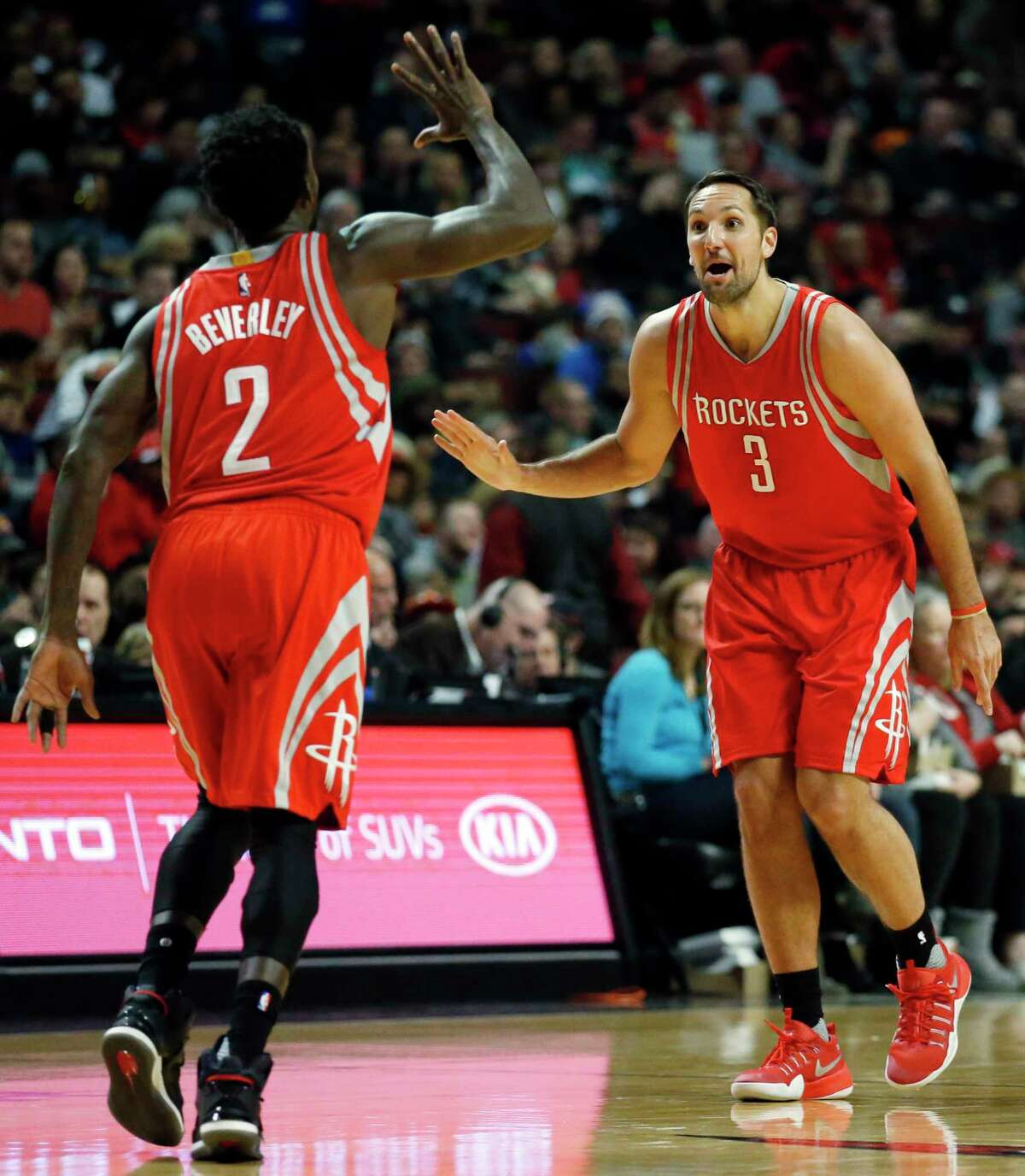 Rockets forward Ryan Anderson, right, celebrates with Pat Beverley after scoring three of his 21 points.