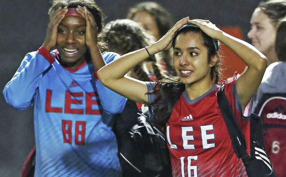 Arianna Sifuentes (right) and Mariah Scott feel the moment of victory as Lee defeats Madison 1-0 in girls soccer at Comalander Stadium on March 10, 2017. Photo: Tom Reel, Staff / San Antonio Express-News / 2017 SAN ANTONIO EXPRESS-NEWS