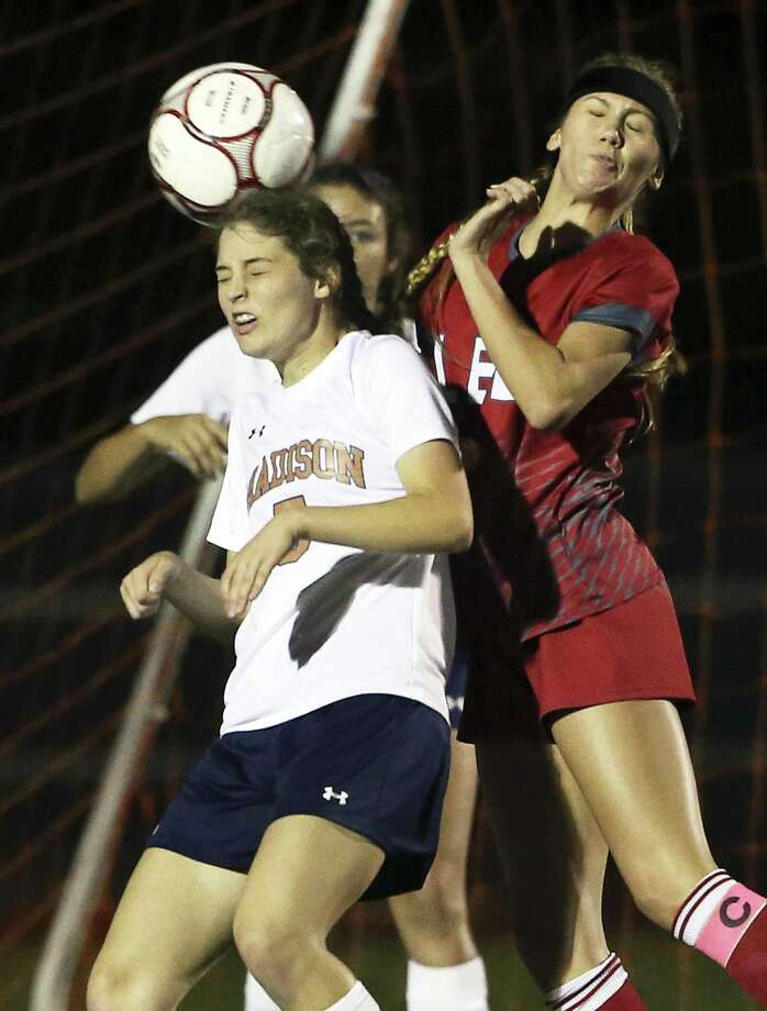 Madison's Alexis Eggleston tries a header at the goal against Kendall Kloza (right) as Lee plays Madison in girls soccer at Comalander Stadium on March 10, 2017. Photo: Tom Reel, Staff / San Antonio Express-News / 2017 SAN ANTONIO EXPRESS-NEWS