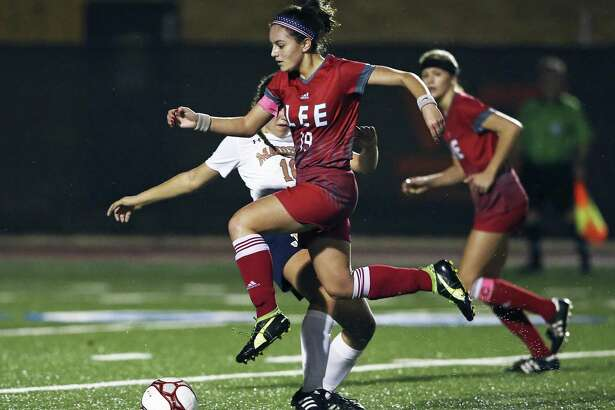The Volunteer's Mazie Jones hops over a tackle on her way upfield as Lee plays Madison in girls soccer at Comalander Stadium on March 10, 2017.