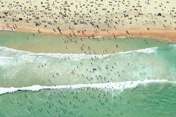 Swimmers take advantage of Sydney's pleasant climate on Bondi Beach.
