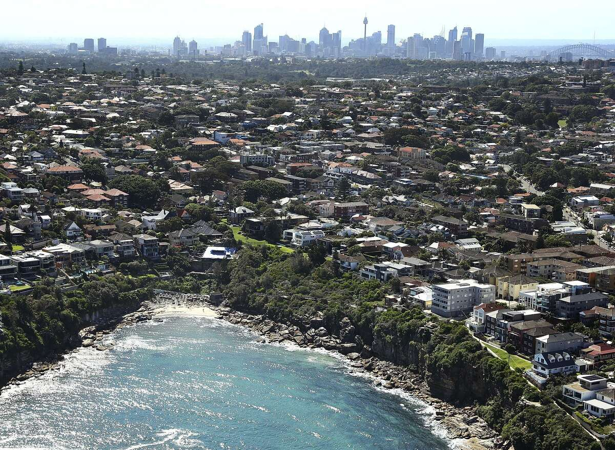 Sydney, a sprawling metropolis of 4 million people, looms large in the background over the suburb of Clovelly and Gordons Bay.