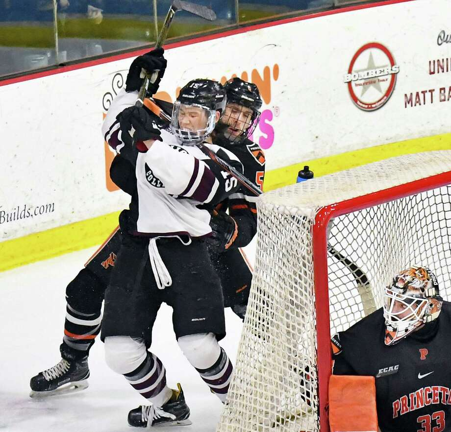 Union's #15 Spencer Foo, left, is fouled by Princeton's #5 Hayden Anderson during game one of their ECAC quarterfinal game at Messa Rink Friday March 10, 2017 in Schenectady, NY.  At right is Princeton goalie Colton Phinney.  (John Carl D'Annibale / Times Union) Photo: John Carl D'Annibale / 20039908A