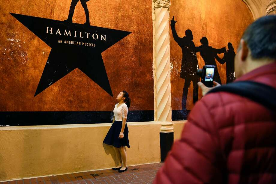 People take pictures in front of Hamilton signs before the plays first public performance at the Orpheum Theater in San Francisco, CA, on Friday March 10, 2017, Photo: Michael Short, Special To The Chronicle